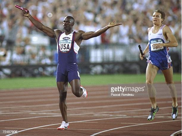 Anthuan Maybank of the USA crosses the line to win the mens 4 X 400 metres with Roger Black of great Britain second at the Olympic Stadium at the...