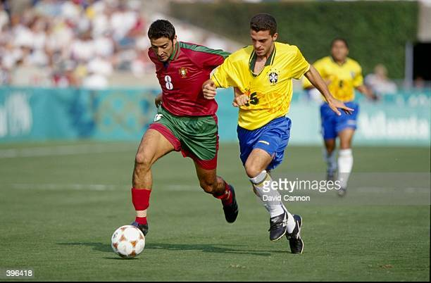 Capucho of Portugal is fighting with Ze Elias of Brazil for the ball in the Men''s Soccer Bronze Medal Match during the 1996 Olympic Games in the...