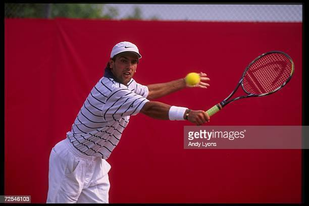 Cedric Pioline goes for the ball during the Du Maurier Open at York University in Toronto Ontario Mandatory Credit Andy Lyons /Allsport