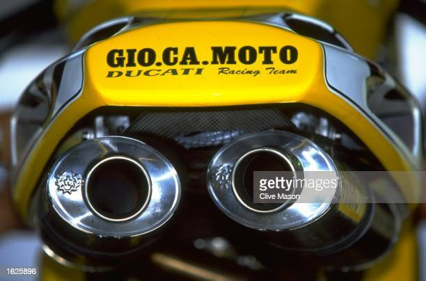 Characteristic exhaust pipes of the all conquering Ducati 916 SP during the World Superbike Championships at Brands Hatch England Mandatory Credit...