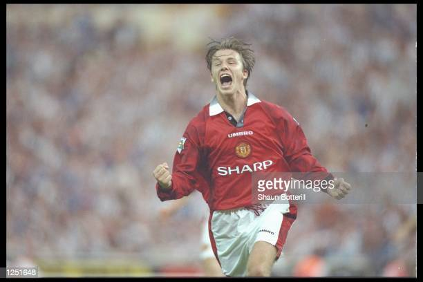 David Beckham of Manchester United celebrates after scoring United's third goal during the FA Charity Shield between Manchester United and Newcastle...