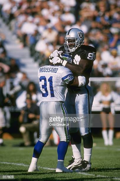 Defensive lineman Aundray Bruce fo the Oakland Raiders comes to blows with running back Steve Broussard of the Seattle Seahawks during a play in the...