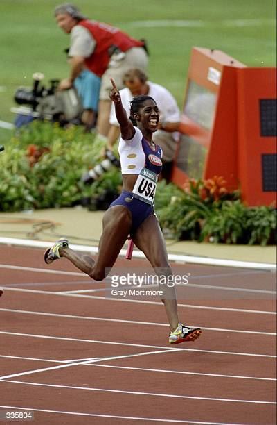 Gwen Terrence of the USA wins as she runs the anchor position in the 4x100m during the 1996 Olympic Games at Olympic Stadium in Atlanta Georgia...