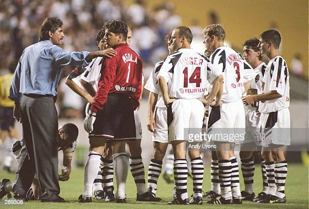 Head coach Carlos Queiroz of the New York/New Jersey MetroStars talks to goaltender Tony Meola and the MetroStars team during a 31 MLS loss to the...