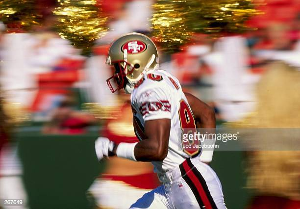 Jerry Rice of the San Francisco 49ers runs past cheerleaders during their game against the San Diego Chargers at 3Com Park in San Francisco...