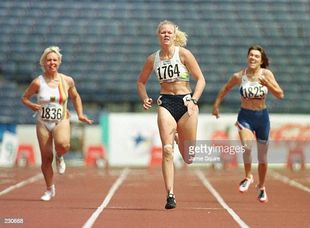 Katrina Webb comes in ahead of Caroline Innes of Great Britain and Simona Kegel of Germany in a semifinal 200m race at Olympic Stadium during the...