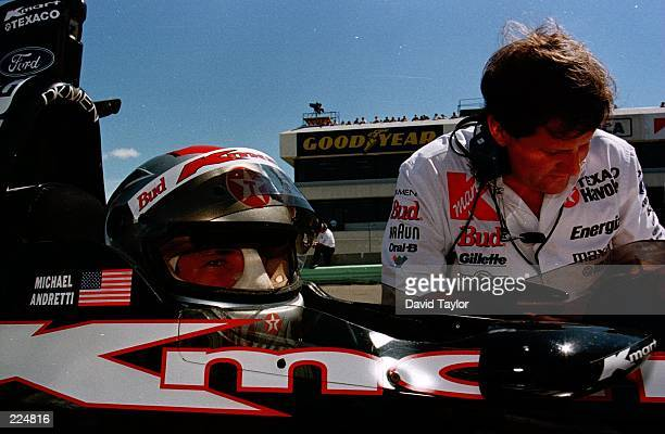 Michael Andretti with his engineer Peter Gibbons prepares to practice his Newman Haas Lola Ford T96/00 at the Texaco/Havoline 200 round fourteen of...