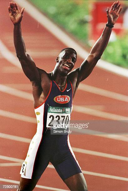 Michael Johnson of the USA celebrates after winning the men's 200m in a new world record time of 1932 seconds in the Centennial Olympic Games at...