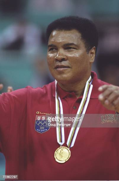 Muhammad Ali receives a replacement gold medal for one he lost many years ago during a halftime ceremony of the Yugoslavia v USA basketball game at...