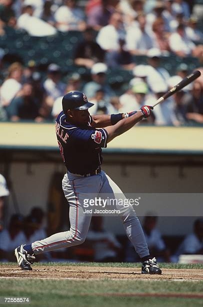 Outfielder Albert Belle of the Cleveland Indians stares into the outfield while following the flight of his hit after making contact with the ball...