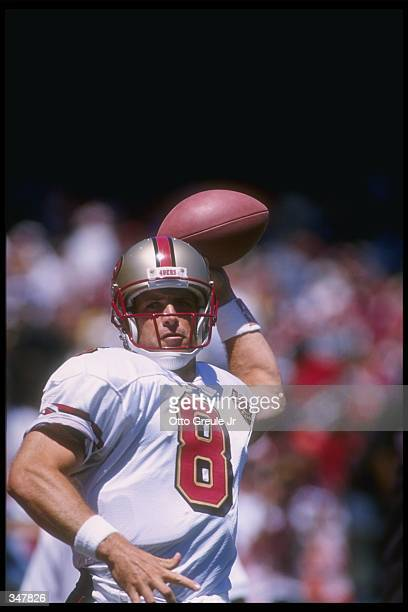 Quarterback Steve Young of the San Francisco 49ers looks to pass the ball during a game against the Denver Broncos at Candlestick Park in San...
