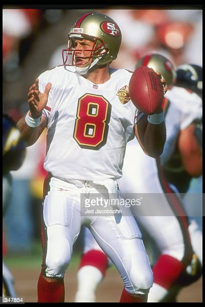 Quarterback Steve Young of the San Francisco 49ers looks to pass the ball during a preseason game against the San Diego Chargers at Candlestick Park...