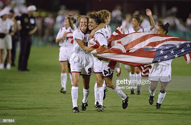 Team USA running and celebrating their win in the Women''s Soccer Finals during the 1996 Olympic Games in the Sanford Stadium in Athens Georgia The...