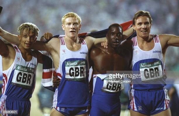 The 4 X 400 relay from Great Britain L to R Jamie Baulch Iwan Thomas Mark Richardson and Roger Black celebrates their silver medal at the Olympic...