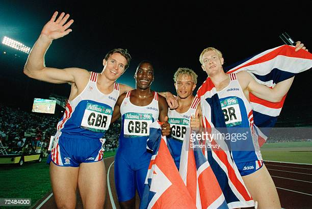 The Great Britain 4 X 400 relay team L to R Roger Black Mark Richardson Jamie Baulch and Iwan Thomas celebrate their silver medals at the Olympic...