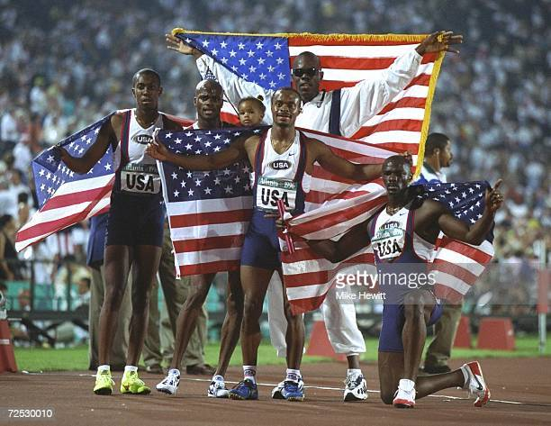 The USA 4 X 400 relay teams celebrate their gold medals at the Olympic Stadium at the 1996 Centennial Olympic Games in Atlanta Georgia