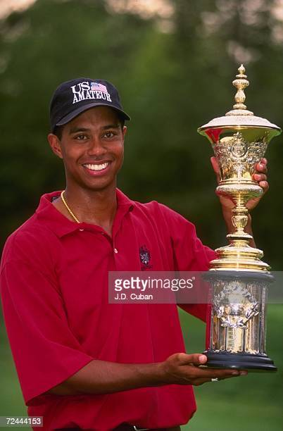 Tiger Woods smiles with the winner's trophy after winning the 1996 US Amateur Championship at Pumpkin Ridge Golf Course in Cornelius Oregon Woods won...