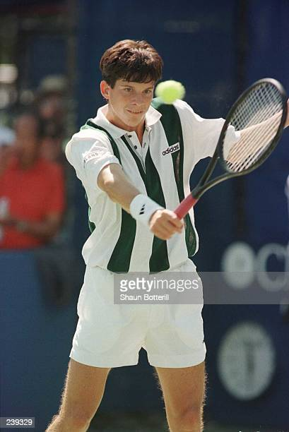Tim Henman of Great Britain focuses on the ball just before attempting a back hand return during his match against Doug Flach of the USA in the...