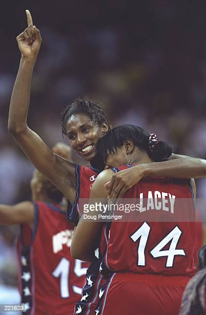 Venus Lacey and Lisa Leslie of the USA celebrate after the USA women's basketball 11187 victory over Brazil to win the gold medal at the Georgia Dome...