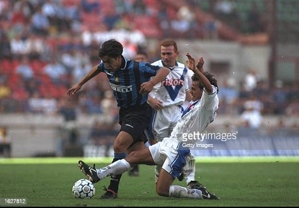 Alvaro Recoba of Inter Milan is tackled by a Brescia defender during the Serie A match at the San Siro in Milan Italy Mandatory Credit Allsport UK...