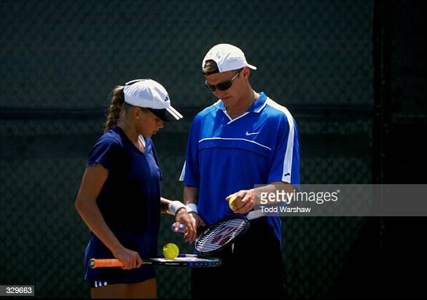Anna Kournikova of Russia chats with Sergei Fedorov during the Acura Classic Tournament at the Manhattan Beach Club in Manhattan Beach California