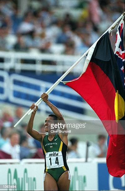 Cathy Freeman of Australia celebrates victory in the 400 metres event at the World Championships at the Olympic Stadium in Athens Greece Mandatory...