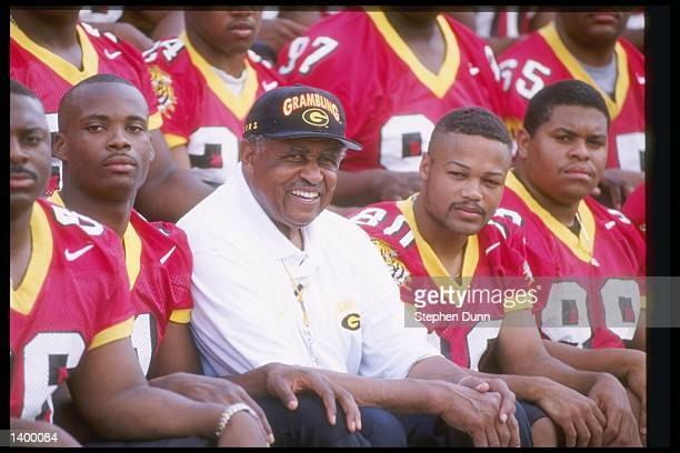 Coach Eddie Robinson of the Grambling State Tigers sits with his team during Media Day in Grambling, Louisiana.
