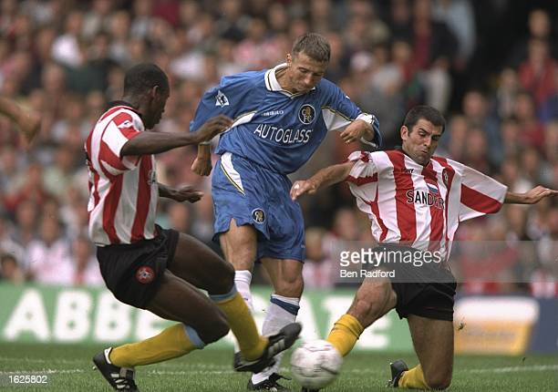 Dan Petrescu of Chelsea attempts to dribble past the challenges of Francis Benali and Ken Monkou of Southampton during the FA Carling Premiership...