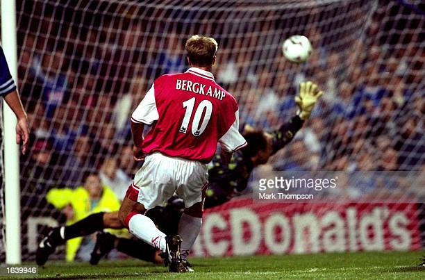 Dennis Bergkamp of Arsenal beats Kasey Keller in the Leicester City goal to score the late equaliser in the FA Carling Premiership match at Filbert...