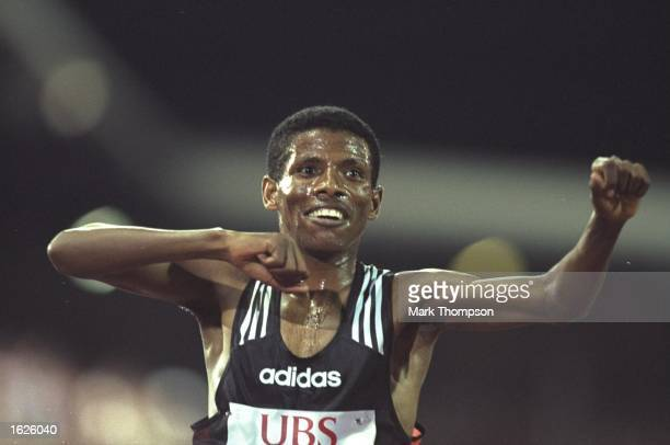 Haile Gebrselassie of Ethiopia celebrates his new world record of 124186 in the 5000 metres at the IAAF Weltklasse Grand Prix at the Letzigrund...