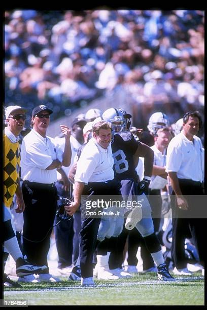 Head coach Joe Bugel of the Oakland Raiders looks on during a preseason game against the New Orleans Saints at the OaklandAlameda County Coliseum in...