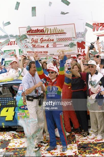 Jeff Gordon celebrates with a giant Winston Million check after winning the Mountain Dew Southern 500 at Darlington Raceway in Darlington South...