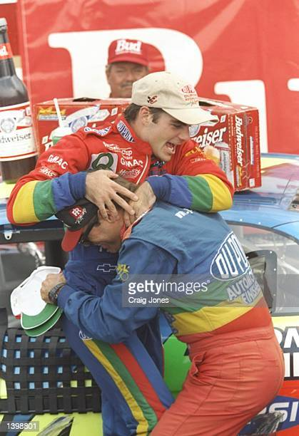 Jeff Gordon celebrates with his crew after the NASCAR Bud at the Glen at Watkins Glen International Speedway in Watkins Glen New York Mandatory...