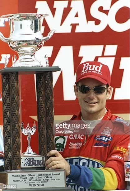 Jeff Gordon poses with a trophy after the NASCAR Bud at the Glen at Watkins Glen International Speedway in Watkins Glen, New York. Mandatory Credit:...