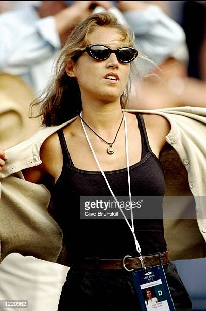 Lucy Heald the girlfriend of Tim Henman takes off her jacket during the US Open Tournament played at Flushing Meadow in New York United States of...