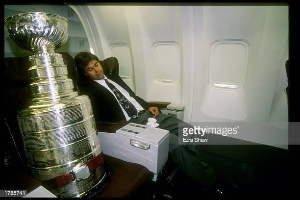 Manager Phil Pritchard of the hockey Hall of Fame relaxes with the Stanley Cup next to him on the Detroit Red Wings trip to Russia at JFK Airport in...
