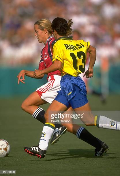 Marisa of Brazil tracks a Norwegian attacker during the women's football match at the Centennial Olympic Games in Atlanta at the Sanford Stadium in...