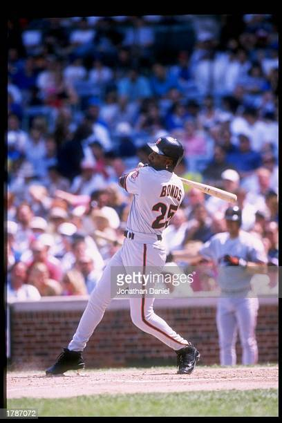 Outfielder Barry Bonds of the San Francisco Giants swings at the ball during a game against the Chicago Cubs at Wrigley Field in Chicago Illinois The...