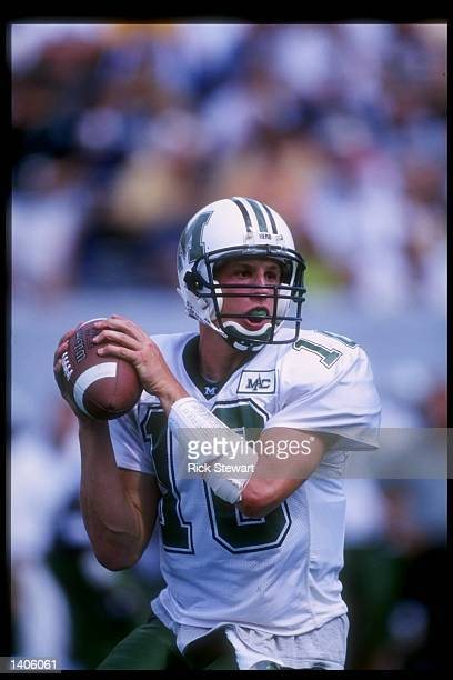 Quarterback Chad Pennington of Marshall University sets to throw a pass during Marshall''s 4231 loss to the West Virginia Mountaineers at Mountaineer...