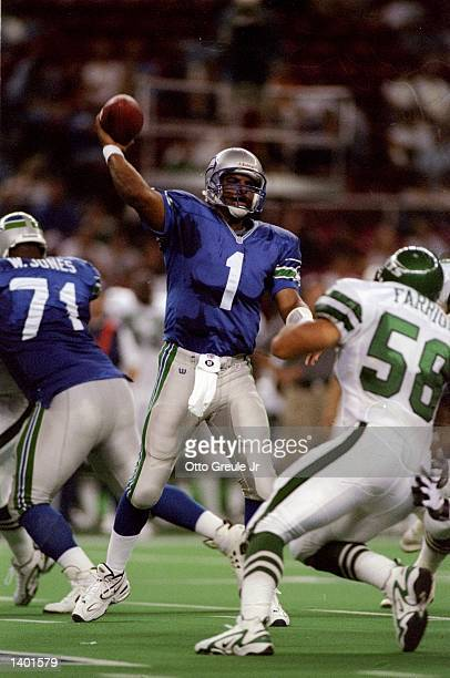 Quarterback Warren Moon of the Seattle Seahawks throws a pass during the Seahawks 413 loss to the New York Jets at the Kingdome in Seattle Washington...