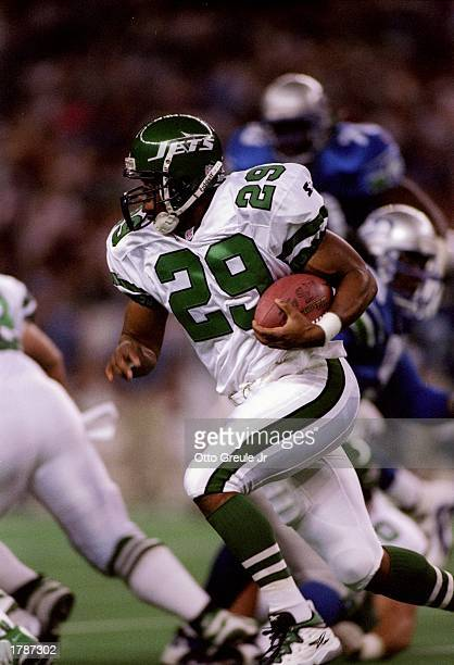 Running back Adrian Murrell of the New York Jets runs down the field during a game against the Seattle Seahawks at the Kingdome in Seattle Washington...