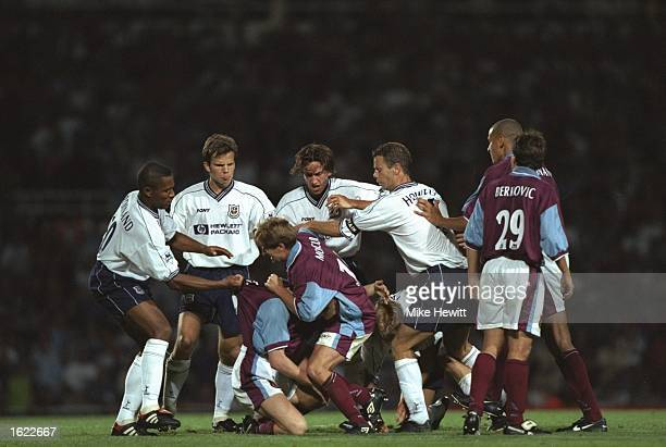 Tottenham Hotspur players left brawl with West Ham United players during the FA Premier League match at Upton Park in London England West Ham won the...
