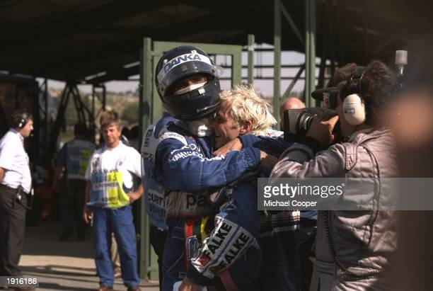 TWR ArrowsYamaha driver Damon Hill of Great Britain embraces WilliamsRenault driver Jacques Villeneuve of Canada after the Hungarian Grand Prix at...