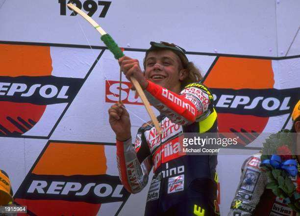 Valentino Rossi of Italy celebrates victory at the British Motorcycle Grand Prix at Donington Park in England Rossi went on to win the 125cc world...