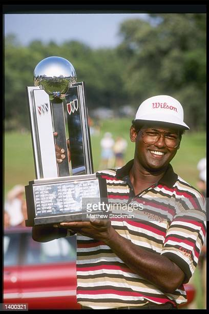 Vijay Singh holds his trophy after winning the Buick Open at the Warwick Hills Country Club in Grand Blanc Michigan Mandatory Credit Matthew Stockman...