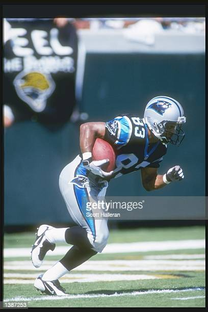 Wide receiver Rae Carruth of the Carolina Panthers moves the ball during a preseason game against the Jacksonville Jaguars at Alltell Stadium in...