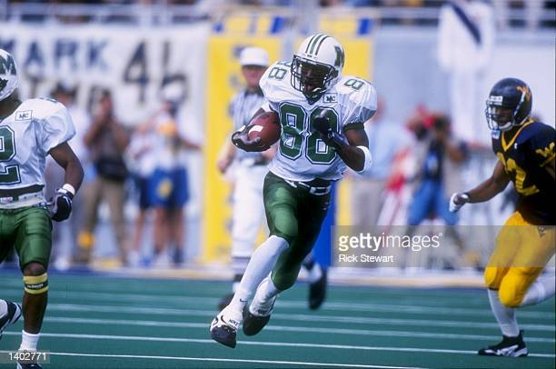 Wide receiver Randy Moss of the Marshall Thundering Herd carries to football during the Thundering Herd 4231 loss to the West Virginia Moutaineers at...