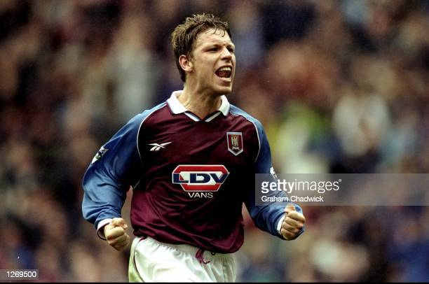 Alan Thompson of Aston Villa celebrates his goal in the FA Carling Premiership match against Middlesbrough at Villa Park in Birmingham England Villa...
