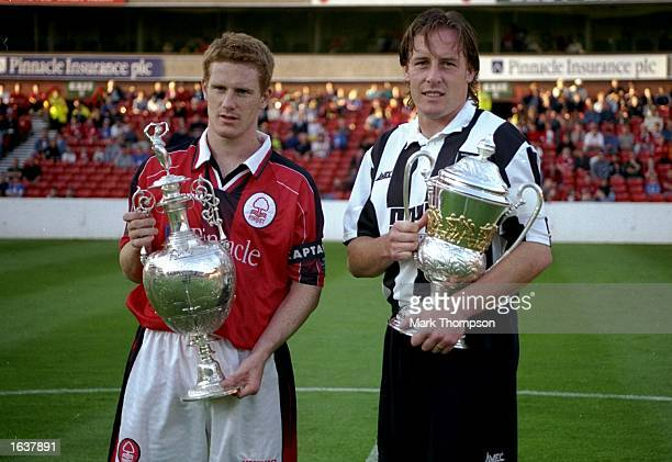 Craig Armstrong of Nottingham Forest and Gary Strodder of Notts County show off last season's divisional trophies before the preseason friendly at...