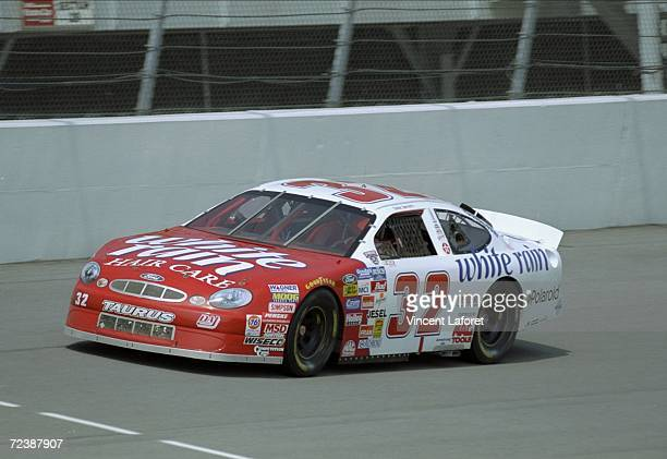 Dale Jarrett driver of the White Rain Ford Taurus in action during the Pepsi 200 at the Michigan Speedway in Brooklyn Michigan